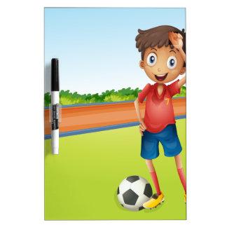 A boy playing football Dry-Erase board