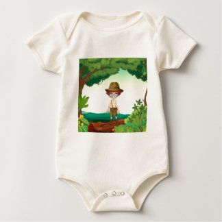 A boy standing on a timber beam baby bodysuits