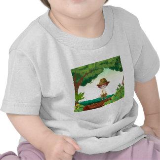 A boy standing on a timber beam t-shirts