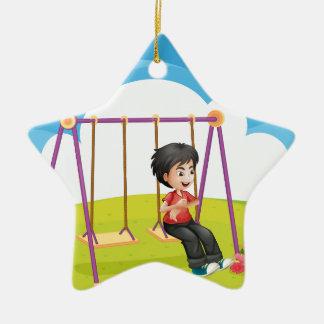 A boy swinging alone christmas ornament