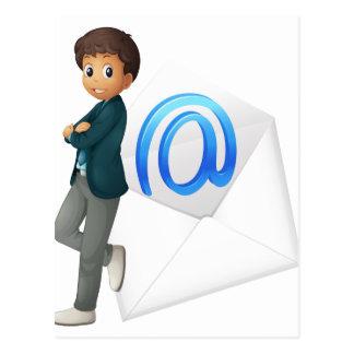 a boy with mail envelop postcard