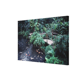 A bridge over a goldfish pond surrounded by canvas print