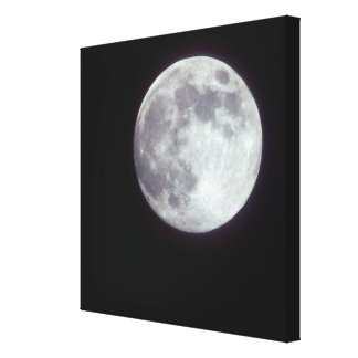 A bright full moon in a black night sky. canvas print