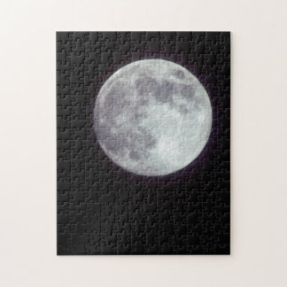 A bright full moon in a black night sky puzzle