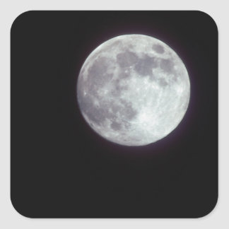 A bright full moon in a black night sky. square sticker