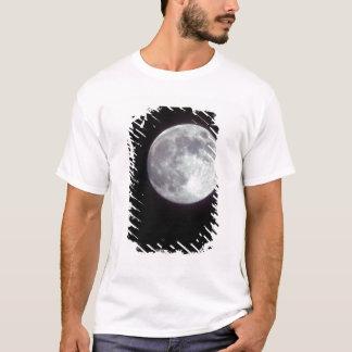 A bright full moon in a black night sky. T-Shirt