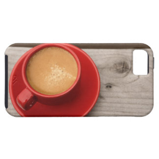 A bright red cup of espresso coffee on a picnic iPhone 5 covers