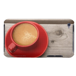 A bright red cup of espresso coffee on a picnic iPod touch case