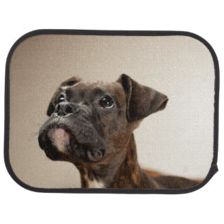 A Brindle Boxer puppy looking up curiously. Floor Mat