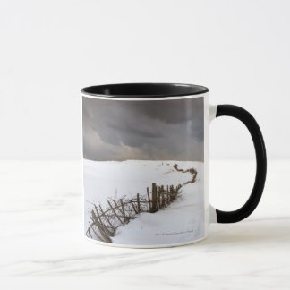 A Broken Fence Along A Snow Covered Field Mug