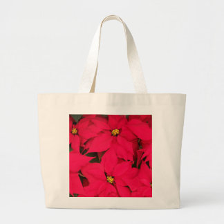 A bunch of Brightly Colored Christmas Poinsettias Bags