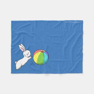 A bunny and a ball fleece blanket