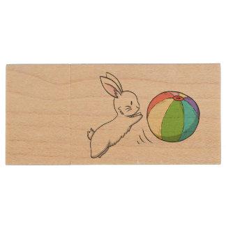 A bunny and a ball wood USB flash drive