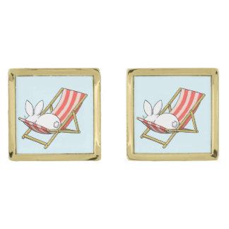 A bunny and a deckchair gold finish cufflinks