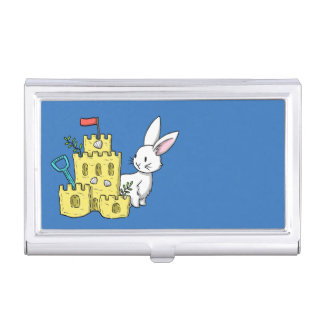 A bunny and a sandcastle business card holder