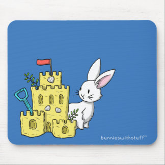 A bunny and a sandcastle mouse mat