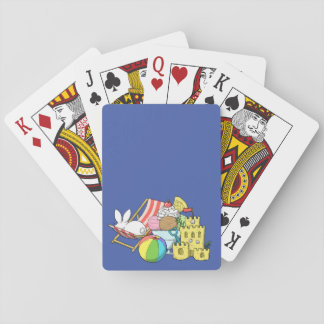 A bunny at the beach playing cards