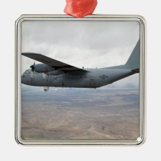 A C-130 Hercules soars through the sky Christmas Ornament