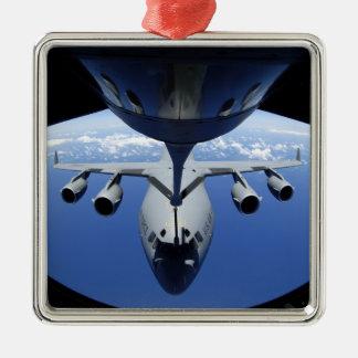 A C-17 Globemaster III receives fuel Christmas Ornament