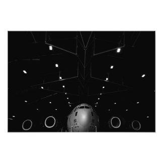A C-17 Globemaster III sits in a hangar Photo Art