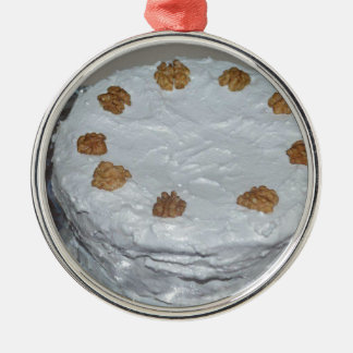 A cake with frosting christmas ornament