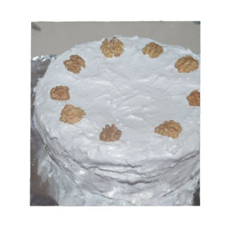 A cake with frosting notepad