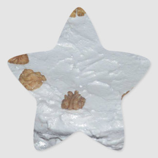 A cake with frosting star sticker