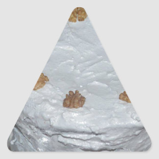 A cake with frosting triangle sticker