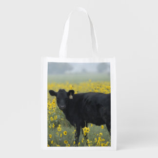 A calf amid the sunflowers of the Nebraska Reusable Grocery Bag