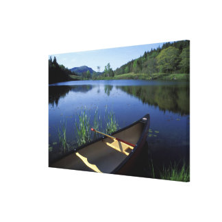 A canoe rests on the shore of Little Long Pond Stretched Canvas Prints