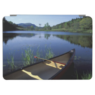 A canoe rests on the shore of Little Long Pond iPad Air Cover
