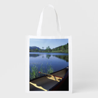 A canoe rests on the shore of Little Long Pond Reusable Grocery Bag