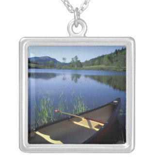 A canoe rests on the shore of Little Long Pond Silver Plated Necklace