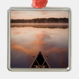 A canoe rests on the shore of Pawtuckaway Lake Christmas Ornament
