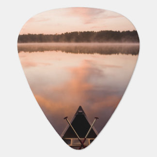 A canoe rests on the shore of Pawtuckaway Lake Plectrum