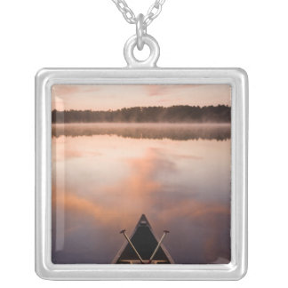A canoe rests on the shore of Pawtuckaway Lake Square Pendant Necklace