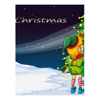 A card with an elf facing the christmas tree postcard