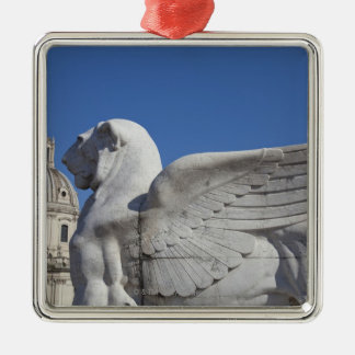 A carved winged lion at the front of the Victor Silver-Colored Square Decoration