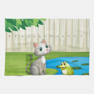 A cat and a frog inside the fence tea towel