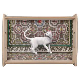 A cat on the mosaic serving tray