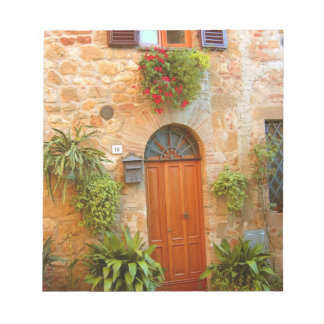 A cat seeks entrance to home in Pienza, Italy. Notepad