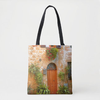 A cat seeks entrance to home in Pienza, Italy Tote Bag