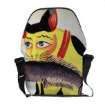 A cat with a fish in its mouth, from the Rudyard K Commuter Bag