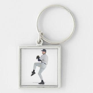 a caucasian man wearing a white baseball uniform key ring
