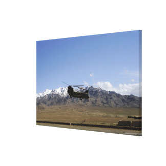 A CH-47 Chinook takes off Canvas Print
