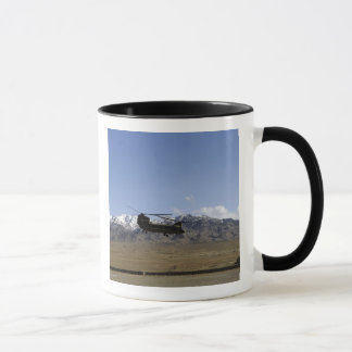 A CH-47 Chinook takes off Mug