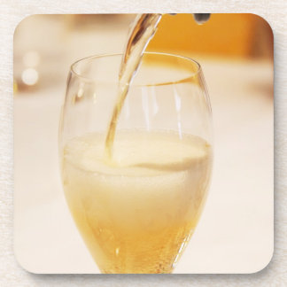 A champagne glass flute being filled with Gosset Coaster