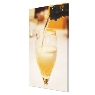 A champagne glass flute being filled with Gosset Gallery Wrap Canvas