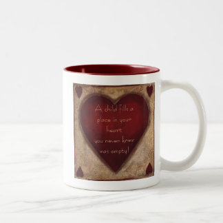 A Child Fills Mug