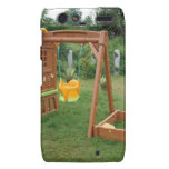 A child's playing equipment in a green location droid RAZR cases